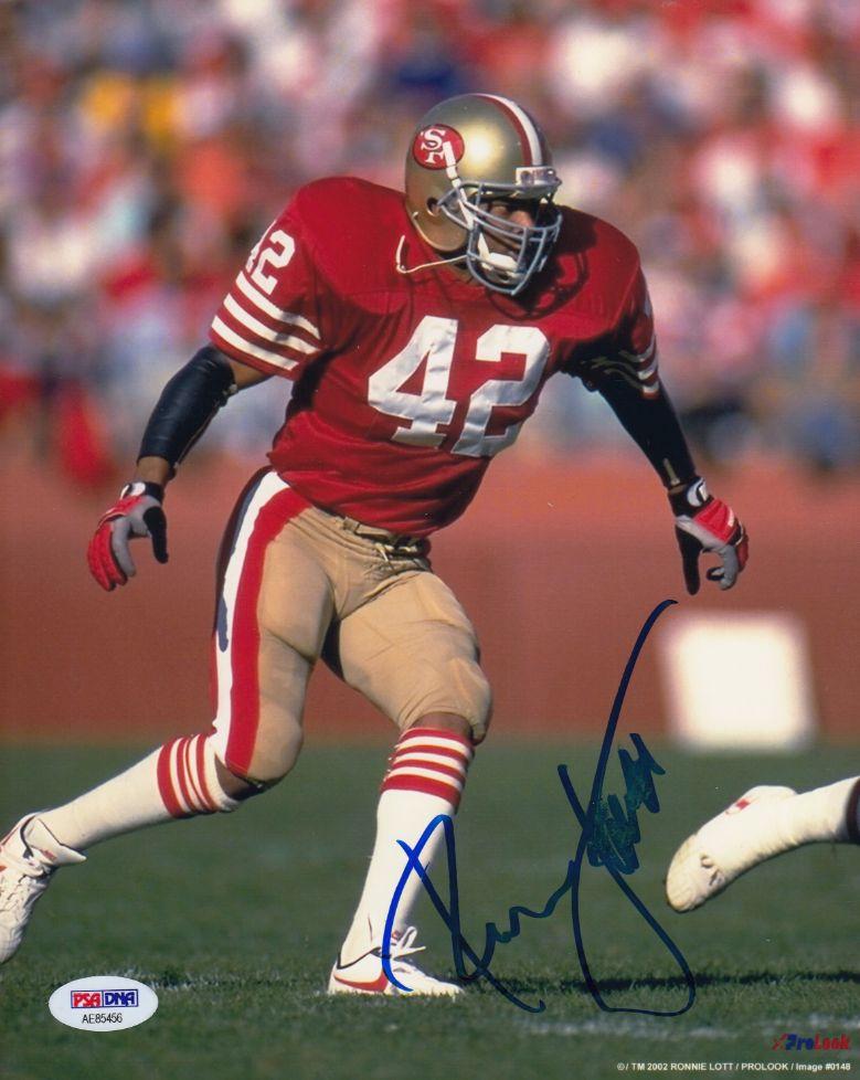 RONNIE LOTT PSA DNA COA Autograph 8x10 49er`s Photo Hand Signed Authentic