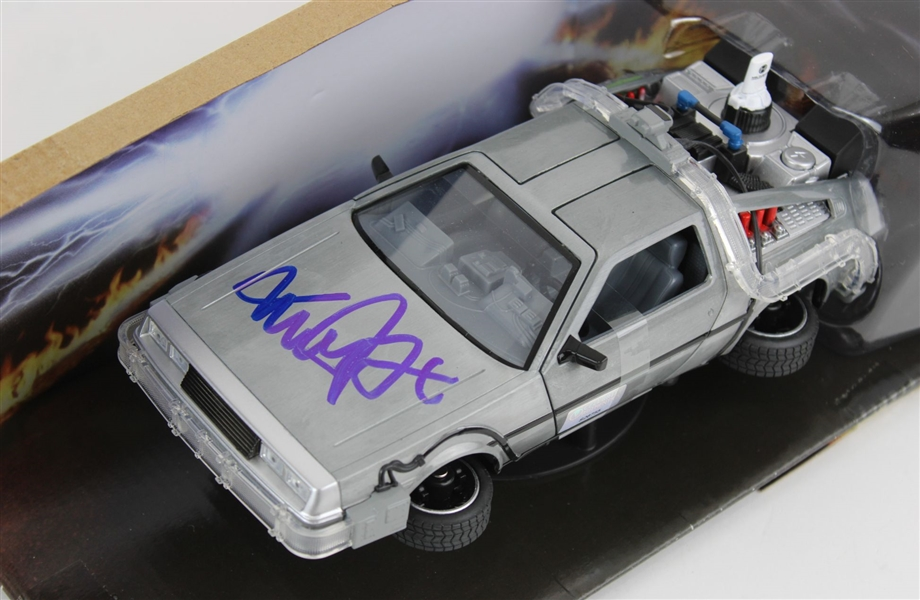 Michael J. Fox Signed Back To The Future DeLorean Time Machine Diecast Car w/ Box (Beckett Witness COA)